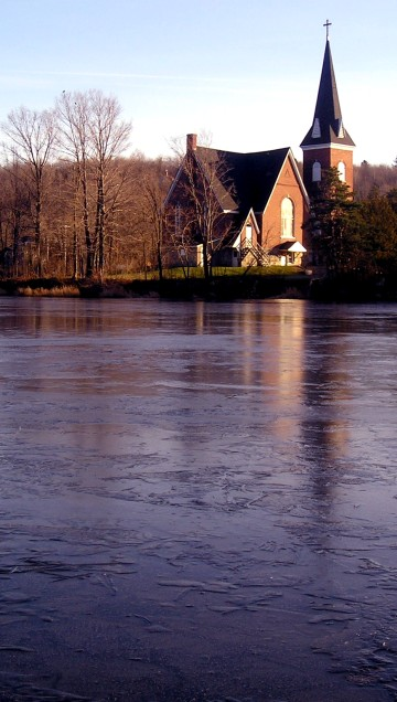 Ice on Mill Pond reflects our lovely Church.