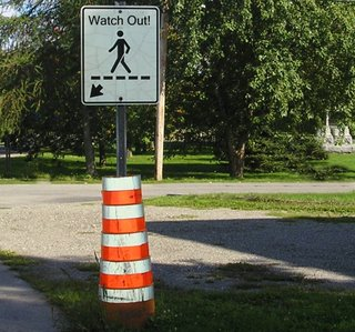 These reflective orange cones and bright signs should make it clear that we need to be carefull and offer the right of way.