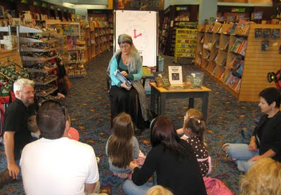 Charis Carter reading to her fans