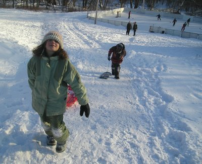 Kids on the hill behind Knowlton Academy stay warm the good old fashioned way!