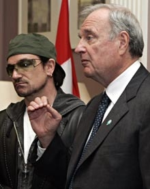 Paul Martin took advantage of his time close to Bono to appear like he really cared. I guess it was where the streets had no name?