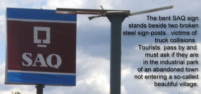 The old IGA parking lot has become a wasteland with a bent SAQ sign and broken signposts Knowlton City Hall seems to think that this is a great representation of a town...